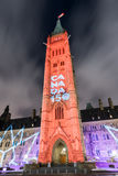 Parliament of Canada. Winter holiday light show projected at night on the Canadian House of Parliament to celebrate the 150th Anniversary of Confederation of Stock Photo