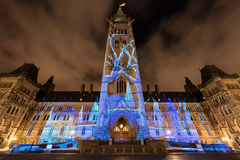 Parliament of Canada. Winter holiday light show projected at night on the Canadian House of Parliament to celebrate the 150th Anniversary of Confederation of Royalty Free Stock Photography