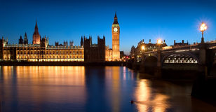 The Parliament of England. The famous landmarks of London: The Parliament, the Big Ben and the Thames by night royalty free stock photo