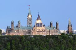 Parliament Hill Canada at Dusk. This image was taken in Ottawa, Canada and shows Canada's Parliament Building from Nepean Point Stock Photo