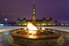 Parliament Hill and the Centennial Flame in Ottawa, Canada. Parliament Hill and the Centennial Flame of Ottawa, Canada at dawn in winter Stock Photo