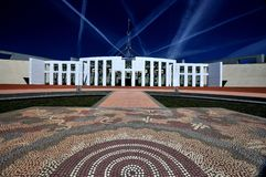 Parliament House Canberra Australia. Close Up Shot with aboriginal design in foreground and jet streams in sky Royalty Free Stock Photos