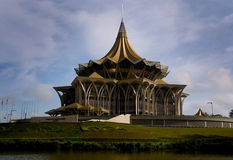 Parliament House, Kuching, Malaysia. The new Parliament House by the river in Kuching modelled on the traditional hat of a field worker royalty free stock photography