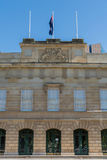 Parliament House of Tasmania in Hobart, Australia. Hobart, Australia - March 19. 2017: Tasmania. Central part of beige stone facade of Parliament House showing Stock Photo