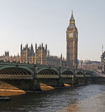 Parliament at midday. A small cityscape of London. This image shows the Houses of Parliament, Big Ben and Waterloo Bridge taken at midday on a cold but clear Stock Photography