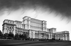 Parliament Palace Bucharest Romania black and white. With big dark stormy clouds coming Stock Image