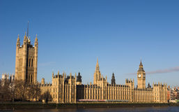 Parliament and Westminster Bridge. View of the houses of parliament from south bank of the Thames royalty free stock image