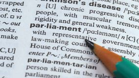 Parliament word in english dictionary, lawmaking council in state government. Stock footage stock footage