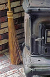 Parlor Stove & Broom Royalty Free Stock Photography