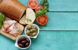 Parma ham, black and green olives Stock Images