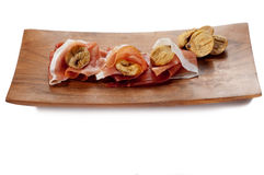 Parma ham and dried fig Stock Photos