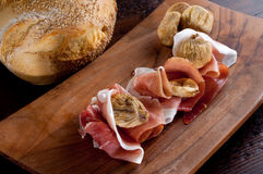 Parma ham and dried fig Stock Photography