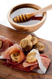Parma ham dried fig and honey Royalty Free Stock Image