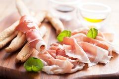 Parma ham and grissini bread sticks Stock Photo