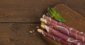 Parma ham on grissini bread sticks Royalty Free Stock Photos