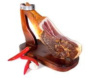 Parma ham ham on wooden stand isolated on white background stock photos