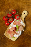 Parma ham (jamon) with fragrant herbs Royalty Free Stock Photos
