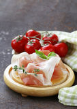 Parma ham (jamon) with fragrant herbs Royalty Free Stock Images