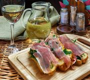 Parma ham (jamon) traditional Italian meat specialties. On the table Stock Photos