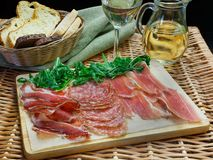Parma ham (jamon) traditional Italian meat specialties. On the table Stock Image