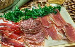 Parma ham (jamon) traditional Italian meat specialties. On the table Stock Photography