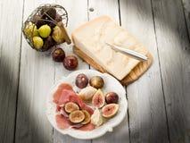 Parma ham, parmesan cheese stock images