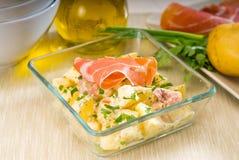 Parma ham and potato salad Stock Images