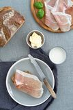 Parma ham on rustic bread. Parma ham on rustic sourdough bread with butter and milk Royalty Free Stock Image