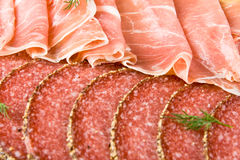 Parma ham and salami. Slices royalty free stock photography