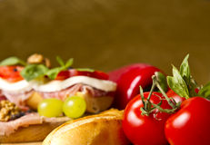 Parma Ham Sandwich with Tomatoes and Basil. A Parma Ham Sandwich with tomatoes, green grapes, walnuts, and red peppers Stock Photography