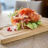 Parma Ham Sandwich On Wooden Plate Lizenzfreie Stockbilder