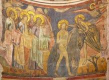 PARMA ITALIEN, 2018: Freskomålningdopet av Jesus i byzantine iconic stil i Baptistery från hantverkare från den Emilia regionen royaltyfri foto