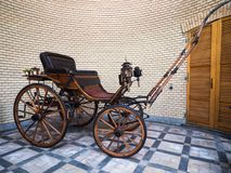 Antique wooden buggy with oil lantern. Parma, Italy - April 8, 2018: Antique wooden buggy with oil lantern Stock Photos
