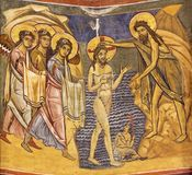 PARMA, ITALY - APRIL 16, 2018: The fresco Baptism of Jesus in byzantine iconic style in Baptistery royalty free stock photo