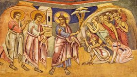 PARMA, ITALY - APRIL 16, 2018: The fresco Jesus healing the ten lepers in byzantine iconic style in Baptistery. Probably by Grisopolo from 13. cent royalty free stock photography