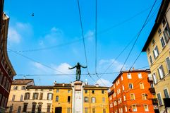 Parma, Italy - colorful Mediterranean architecture and monument to soldier Stock Images
