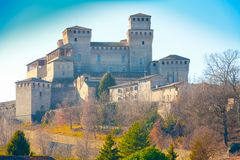 Torrechiara castle at sunset Italy stock photography