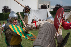 Parma, Italy - may 2015: Knights in Battle with Silver Helmets and Armors Stock Image