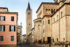 Parma, Italy. Old street leading to high tower on Piazza Duomo, Parma, Italy Stock Photography