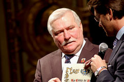 Parma Major and Lech Walesa. The Parma city major is awarding The Peace Nobel prize Lech Walesa with a sheet to commemorate the 25° anniversary of his Nobel Royalty Free Stock Photos