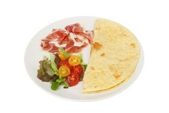 Parma, piada and salad. Parma ham, salad and piada bread on a plate isolated against white Stock Photos
