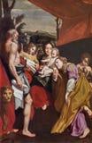 Parma - pintura de Madonna com a criança St Jerome e St Mary Magdalen na igreja Chiesa di San Vitale como a cópia de Correggio imagens de stock royalty free