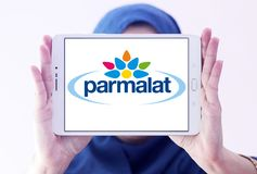 Parmalat Food processing company logo. Logo of Parmalat company on samsung tablet holded by arab muslim woman. Parmalat SpA is a multinational Italian dairy and Stock Image