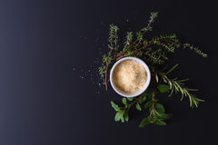 Parmesan and aroma herbs Stock Photography