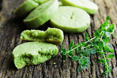 Parmesan biscuits with tea match and thyme. Royalty Free Stock Image