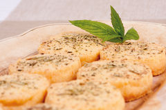 Parmesan cheese. Freshly baked Parmesan cheese biscuits with black pepper, mint and rosemary stock photo