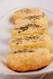 Parmesan cheese biscuits. Freshly baked Parmesan cheese biscuits with black pepper, mint and rosemary royalty free stock photo