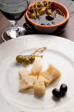 Parmesan cheese  with black olives and capers Stock Photo