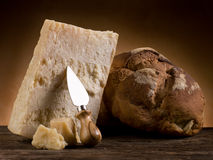 Parmesan cheese and bread. Parmesan cheese with knife and bread Royalty Free Stock Images