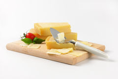 Parmesan cheese and cheese knife Stock Photos